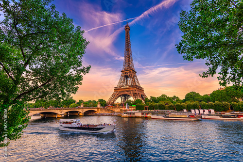 Wall mural Paris Eiffel Tower and river Seine at sunset in Paris, France. Eiffel Tower is one of the most iconic landmarks of Paris.