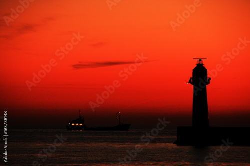 The lighthouse in a sunset