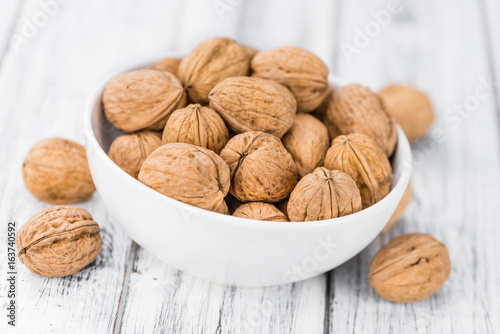 Portion of Whole Walnuts on wooden background (selective focus) - 163740592