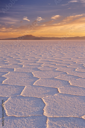 Salt flat Salar de Uyuni in Bolivia at sunrise