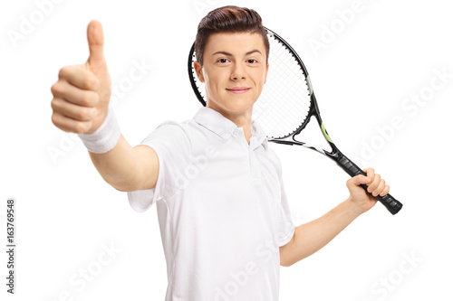 Teenage tennis player making a thumb up sign