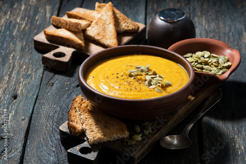 pumpkin soup with toasts - 163773359