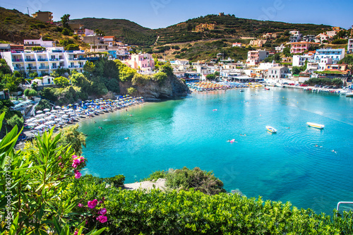 Aluminium Poort Bali, Island Crete, Greece, Sunny day scenery scenery with mountains, Mediterranean sea, flowers and pier with boats and ship for walking tourists in the sea near village Bali