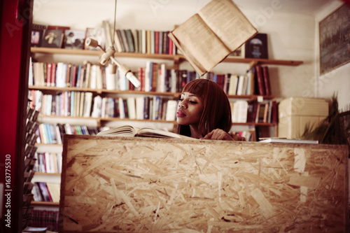 Poster African woman in library