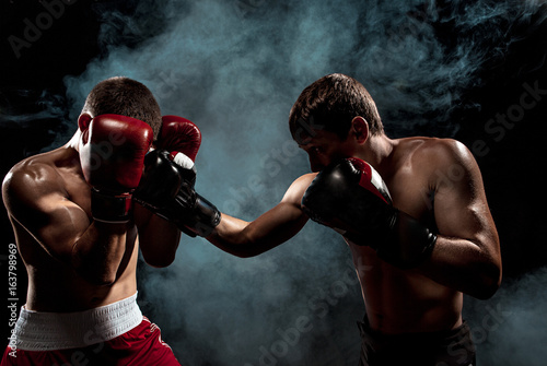 Two professional boxer boxing on black smoky background, Poster