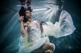 Woman underwater - 163800516