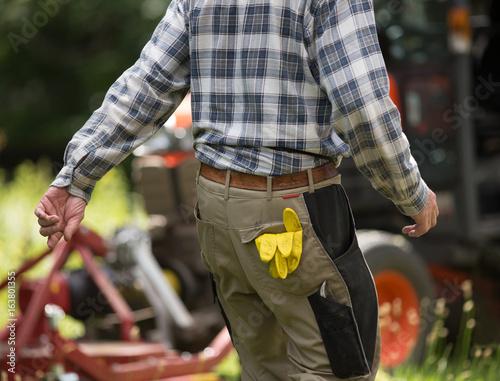 Gardener with gloves in pocket