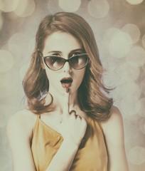 American redhead girl in sunglasses.
