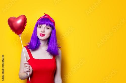 girl with purple hair with heart shape balloon