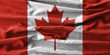 Canada flag painting on high detail of wave cotton fabrics .