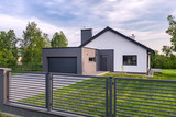 Villa with fence and garage - 163839398