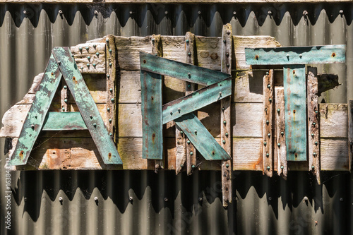 letters ART on corrugated iron fence Poster