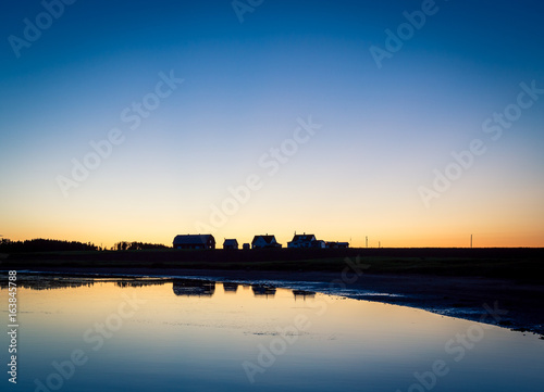 reflection of house and barn