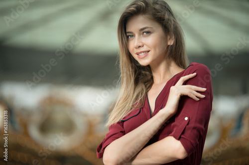 Young woman in red skirt with expectant look