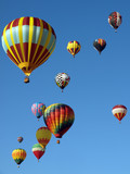 Colorful Hot Air Balloons Fly in a Clear Blue Sky - 163856140