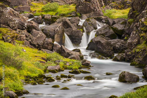 Waterfall Long Exposure iwth grass and rocks Poster