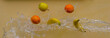 Banana, orange, and apple flying in water droplets - 163895156