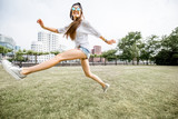 Young woman tourist having fun in Rheinpark at the modern disstrict of Dusseldorf city, Germany
