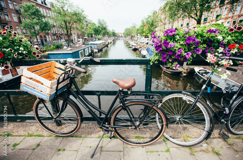 NETHERLANDS, AMSTERDAM – JUNE 15,2017: Veiw on the bridge through the river chan Poster