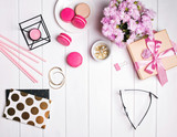 Cute small feminine accessories on the white wooden table