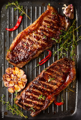 Grilled  strip steak with spices - 163954116