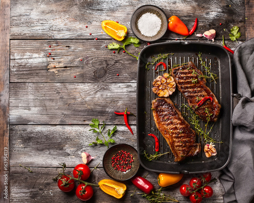 Grilled  strip steak with spices - 163954139