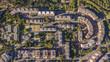 Vista aerea ortogonale di un quartiere periferico della città di Roma. Le costruzioni sono moderne e anche l'urbanistica è futuristica. Tanti sono gli alberi piantati intorno alle abitazioni.