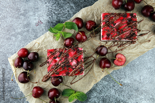 Home made cherry cake with vanilla, cream cheese and black cherries