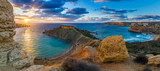 Fototapety Mgarr, Malta - Panorama of Gnejna bay and Golden Bay, the two most beautiful beaches in Malta at sunset with beautiful colorful sky and golden rocks taken from Ta Lippija