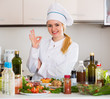 Positive chef posing with vegetable mix and cheese - 163987321