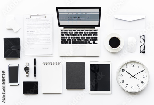 Aerial view of computer laptop with office stationery isolated on white