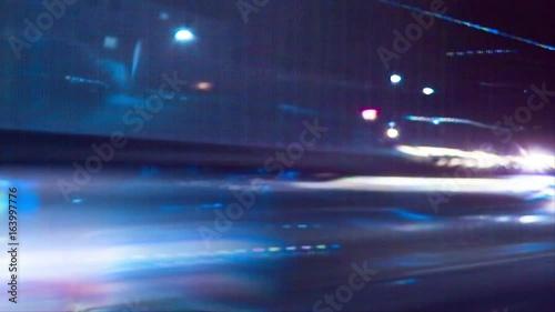 Street Lights 1039: Night lights streak as we travel down a city street (Loop).