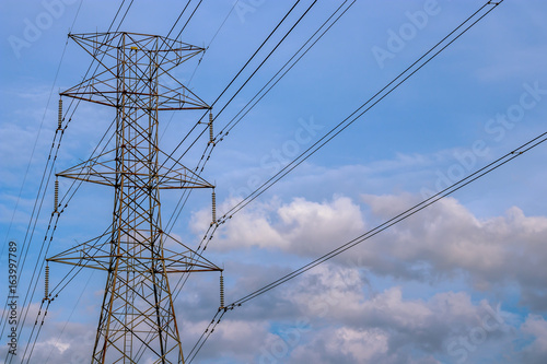Close up view of high voltage tower with cables Poster