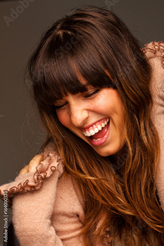 Beautiful young happy woman laughing and smiling.