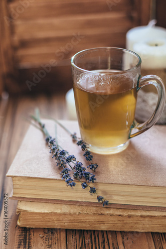 Herbal tea and reading on rustic windowsill