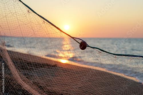 Sea, beach and fishing net