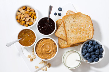peanut butter, jams and toasts for breakfast, top view