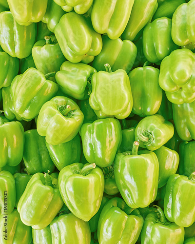 organic green bell peppers top view, natural background