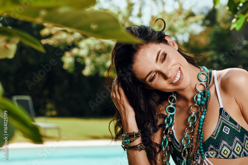 Model Posing Next to Swimming Pool in garden
