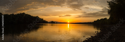 summer sunset on beach by river. cloudy beauty sunset in summer