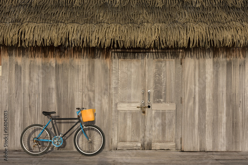 Wooden walls with doors and bicycles parked.