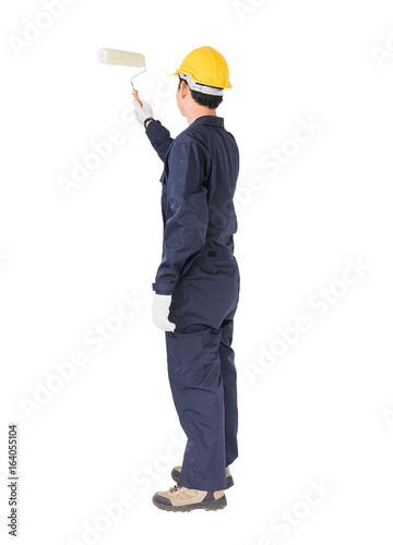 Poster Worker in a uniform using a paint roller is painting invisible floor