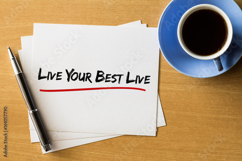 Live your best live - handwriting on papers with cup of coffee and pen, motivati Poster