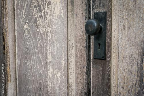 Rustic vintage door knob on antique door wood. Door knob and keyhole made of brass & Rustic vintage door knob on antique door wood. Door knob and keyhole ...