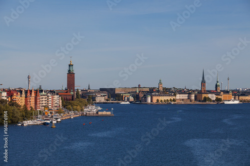 Scenic summer aerial view of old town, city hall and central embankments with boats. Stockholm, Sweden