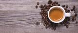 tazzina di caffè espresso su fondo legno - 164082744
