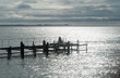 Silhouette of a fisherman fishing on a pier on the Black Sea coast in Abkhazia