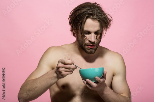 bearded naked sexy man has breakfast in the morning Poster