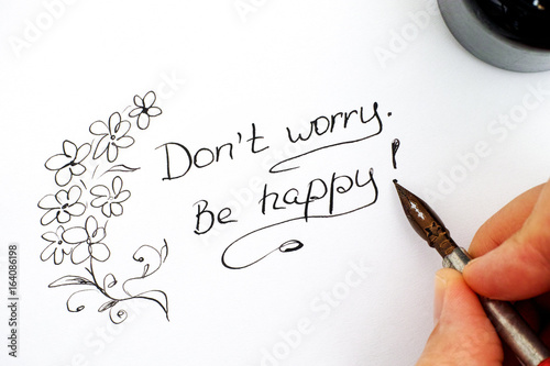 Woman fingers with pen writing phrase Do not worry. Be happy! Poster