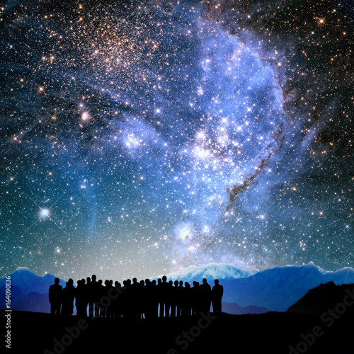 Fototapeta silhouetted people and lights of universe